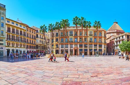 MALAGA, SPAIN - SEPTEMBER 26, 2019: Historical architecture of Constitution Square, famous for fashion stores, cafes, museums and ornate Fuente de Genova (Genoa Fountain), on September 26 in Malaga Standard-Bild