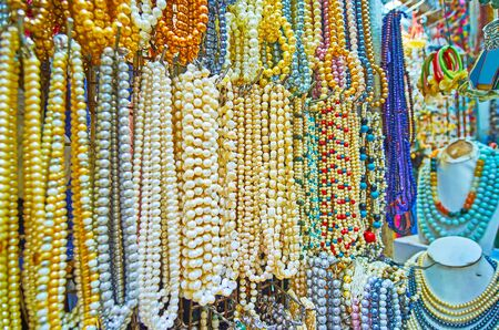 Different natural pearl and gem beads in jewelry stall of Bogyoke Aung San Market, Yangon, Myanmar Stock Photo