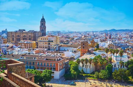 Architecture of the old town with dominating medieval Cathedral from the rampart of Alcazaba fortress, Malaga, Spain