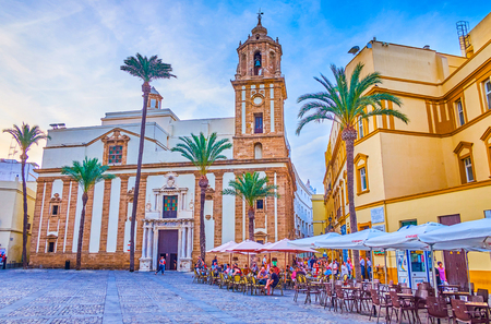 CADIZ, SPAIN - SEPTEMBER 19, 2019: Cathedral Square is the most beloved places among tourists and the most photogenic in the city due to amazing Andalusian style buildings, on September 19 in Cadiz
