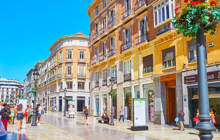 MALAGA, SPAIN - SEPTEMBER 26, 2019: Calle Larios streetscape with crowd of people, modern stores, boutiques and cafes, on September 26 in Malaga