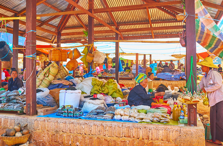 KAKKU, MYANMAR - FEBRUARY 20, 2018: The stall of Kakku market offers such farmers products as sunflower seeds, oil, snacks and dried gourd bottles, on February 20 in Kakku.