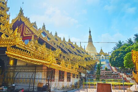 The slope of Singuttara hill is covered with ornamental garden, stretching along the East Stairway of Shwedagon Pagoda, Yangon, Myanmar