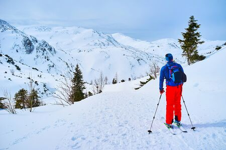 The skier observes the route of Feuerkogel Mountain plateau, Ebensee, Salzkammergut, Austria