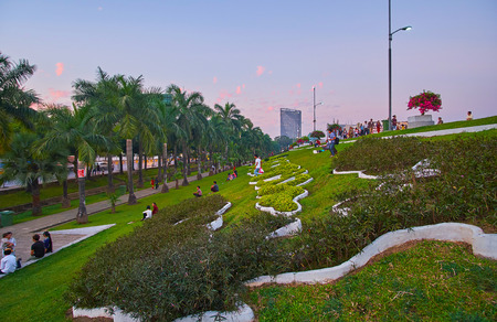 YANGON, MYANMAR - MARCH 2, 2018: Inya lake park is one of the most popular city recreational zone with perfect landscaping and nice sites, on March 2 in Yangon