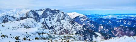 Alberfeldkogel mount overlooks the rocky Dachstein Alps, covered with snow and poor coniferous vegetation, Ebensee, Salzkammergut, Austria Zdjęcie Seryjne
