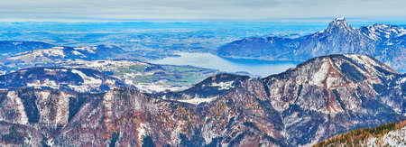 The view from peak of Alberfeldkogel mount on the rocky valley of Traunsee lake and cone of Traunstein Mount on the background, Salzkammergut, Austria