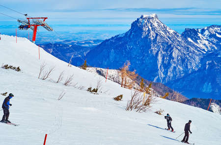 The gentle white slopes of Feuerkogel Mount are popular among the skiers and boarders, spending winter in Alps, Ebensee, Salzkammergut, Austria