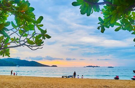 Watch the cloudy sunset sky over Andaman sea coast in Patong, Phuket, Thailand