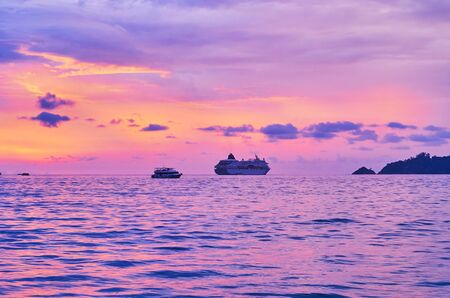 The purple sunset sky over Andaman sea with a view on cruise liner on horizon, Patong, Phuket, Thailand Reklamní fotografie