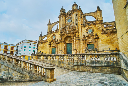 Exterior of medieval stone Holy Saviour Cathedral with ornate carvings and flying buttresses, located in Plaza de la Encarnacion (Incarnation Square) of Old Town, Jerez, Spain