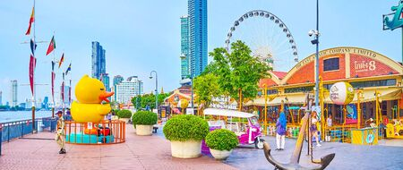 BANGKOK, THAILAND - APRIL 15, 2019: Panoramic view on the promenade of Asiatique shopping area, the most beloved part of the complex amont visitors, on April 15 in Bangkok