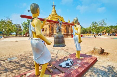 The Buddhist ritual bell with sculptures, holding it, located at the Alo-daw Pyi Pagoda, Bagan, Myanmar
