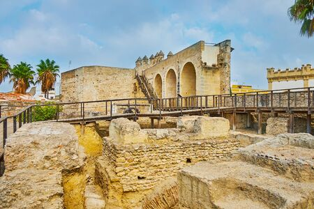 Walk among the ancient stone ruins of Alcazar fortress, Jerez, Spain