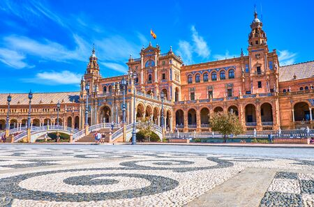 The beautiful pebbled pavement with geometrical pattern on Plaza de Espana in Seville, Spain