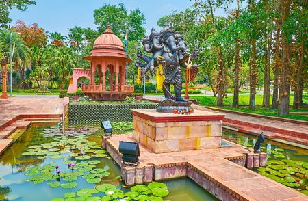 The statue of multi-headed Ganesha and ochre pavilion on the small pond of India garden, located in Rajapruek Park, Chiang Mai, Thailand 에디토리얼
