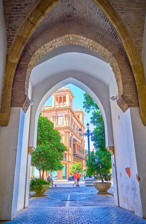 SEVILLE, SPAIN - OCTOBER 1, 2019:  The old Portillo De La Muralla gates of the medieval city walls, nowadays the remains of historical defensive fortification, on October 1 in Seville