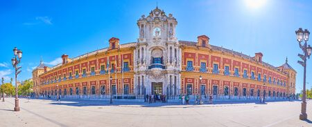 SEVILLE, SPAIN - OCTOBER 1, 2019: Panoramic view on large facade of Palace of San Telmo wit hscenic central stone portal, on October 1 in Seville
