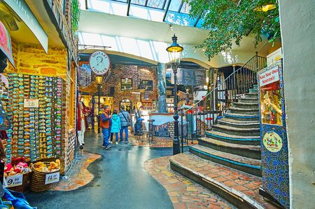 VIENNA, AUSTRIA - FEBRUARY 19, 2019: The hall of Hundertwasser village - pavilion, serving as the handicraft market with stalls, workshops and lounge bar, on February 19 in Vienna