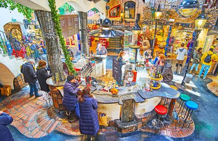 VIENNA, AUSTRIA - FEBRUARY 19, 2019: Explore Hundertwasser Village market with its unusual design, cozy lounge, workshops, stores and art galleries, on February 19 in Vienna Stockfoto - 140376569