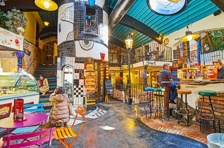 VIENNA, AUSTRIA - FEBRUARY 19, 2019: Interior of Hundertwasser Village - the covered market, with lounge bar amid the stalls and handicraft workshops, on February 19 in Vienna