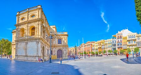 SEVILLE, SPAIN - OCTOBER 1, 2019: Panoramic view on Plaza de San Francisco with colorful buildings with outdoor terraces and monumental City Council building of Seville, on October 1 in Seville