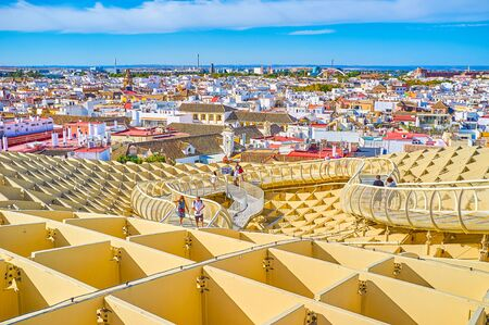 SEVILLE, SPAIN - OCTOBER 1, 2019: Metropol Parasol is a very popular tourist destination due to amazing views on old town from the top of high modern construction, on October 1 in Seville