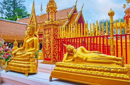The golden sculptures of Reclining Buddha and Buddha Touching Earth (Earth Witness) in Wat Phra That Doi Suthep temple, Chiang Mai, Thailand
