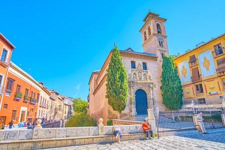GRANADA, SPAIN - SEPTEMBER 25, 2019: The facade of medieval San Gil and Santa Ana church, located in Plaza Santa Ana square of historic Arabic Albaicin district, on September 25 in Granada