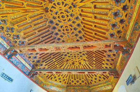 GRANADA, SPAIN - SEPTEMBER 27, 2019: Ornate woodwork on ceiling of the Knigts Hall (Sala de Caballeros) of Palacio de la Madraza (Madrasah), including details of Mudejar style and Christian tradition, on September 27 in Granada