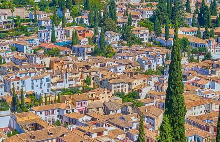 The tile roofs of Granada Old Town with Albaicin (Albayzin) district, seen from the tower of Alhambra palace, Andalusia, Spain Reklamní fotografie