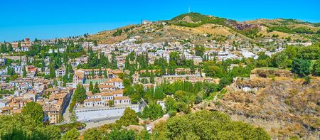 Panoramic aerial view of Sacromonte and Albaicin districts of old Granada, located on the slope of the hill, Spain