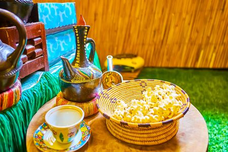 Explore Ethiopian coffee traditions, try hot black coffee, made in jebena boiling pot, with fresh popcorn