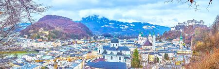 Watch Salzburg old town panorama from Monchsberg Hill - Hohensalzburg Fortress dominates the skyline and Salzach river divides city into two parts, Austria Banco de Imagens