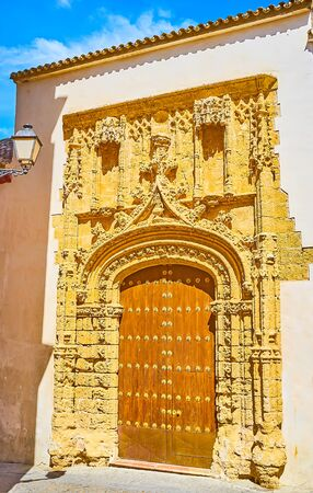 The medieval carved gate of Incarnation Convent, decorated with rich carvings in Plateresque style and located in Monjas street, Arcos, Spain