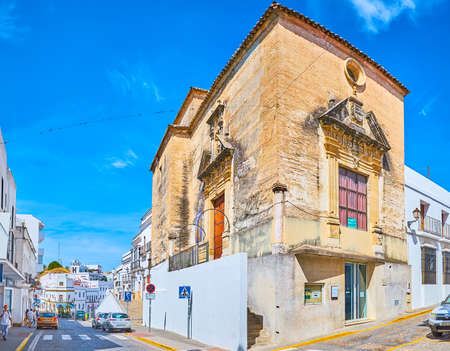 ARCOS, SPAIN - SEPTEMBER 23, 2019: Exterior of medieval San Miguel church, located in Calle Corredera street of pueblo blanco (white town), on September 23 in Arcos Editoriali