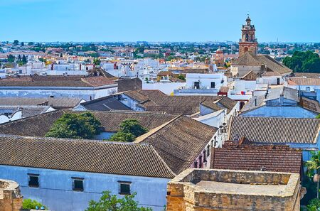 Aerial view of Bodegas Barbadillo winery roofs and bell tower of Our Lady of O church, rising over the city, Sanlucar, Spain
