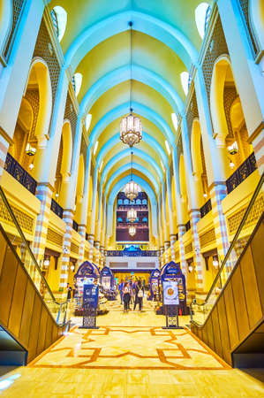 DUBAI, UAE - MARCH 3, 2020: The main hall of Al Bahar Souq with shiny interior in Arabic authrentic style and with kiosks in the middle of alley, on March 3 in Dubai