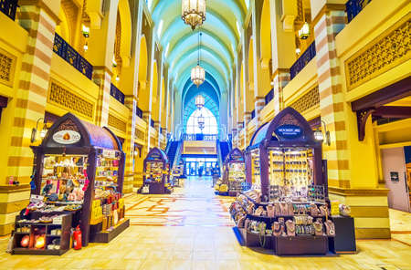 DUBAI, UAE - MARCH 3, 2020: The line of small kiosks in Al Bahar Souk sail Arabic style jewelry, perfumes, accessories and house decorations, on March 3 in Dubai