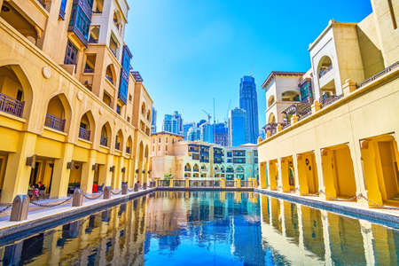 DUBAI, UAE - MARCH 3, 2020: The inner courtyard with a small pool on the roof of Old Town Island's buildingds with outdoor terrace of restaurant, on March 3 in Dubai