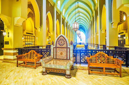 DUBAI, UAE - MARCH 3, 2020: The wooden chair with splendid inlays of ivory and nacre stands on the balcony in Al Bahar Souk (market), on March 3 in Dubai