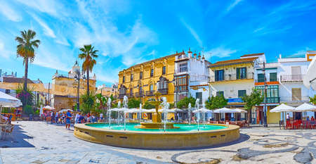 SANLUCAR, SPAIN - SEPTEMBER 22, 2019: Panorama of Plaza del Cabildo square with fountain, old town houses, outdoor cafes and wine bars, on September 22 in Sanlucar Editorial