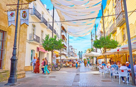 SANLUCAR, SPAIN - SEPTEMBER 22, 2019: Calle Ancha is main shopping promenade, lined with bars, restaurants, fashion boutiques and souvenir shops, located in old edifices, on September 22 in Sanlucar Imagens - 150301929