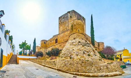 Panorama of Castillo de Santiago with massive ramparts, circle watchtowers and huge rectangular Homenaje tower, Sanlucar, Spain