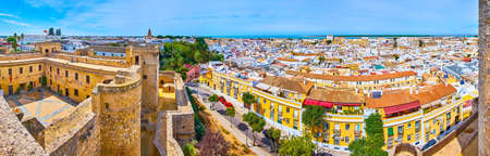 Santiago Castle of Sanlucar is the perfect place to observe the panorama of old town with tile roofs, stone domes of churches and Guadalquivir river, Andalusia, Spain Imagens - 150999395