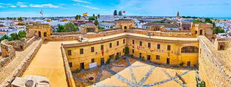 SANLUCAR, SPAIN - SEPTEMBER 22, 2019: The top panorama from Homenaje tower of Santiago Castle with a view on medieval courtyard and  white houses, on September 22 in Sanlucar Editorial