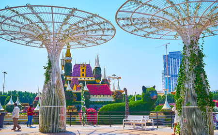 DUBAI, UAE - MARCH 5, 2020: The giant airy white sunshades in front of the floral fairytale castle of Miracle Garden, on March 5 in Dubai