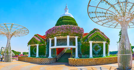 DUBAI, UAE - MARCH 5, 2020: Panorama of floral pavilion, serving as the observation deck atop the hill in Miracle Garden, on March 5 in Dubai