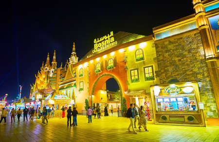 DUBAI, UAE - MARCH 5, 2020: The facade of Bosnia and Balkans Pavilion of Global Village Dubai, decorated in style of Balkanian traditional houses, on March 5 in Dubai