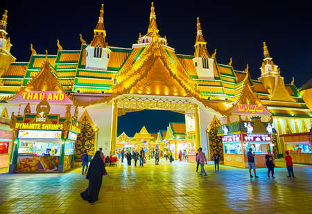 DUBAI, UAE - MARCH 5, 2020: The facade of Thailand Pavilions of Global Village Dubai with traditional pyathat (multitired) roof, topped with chedi towers, on March 5 in Dubai
